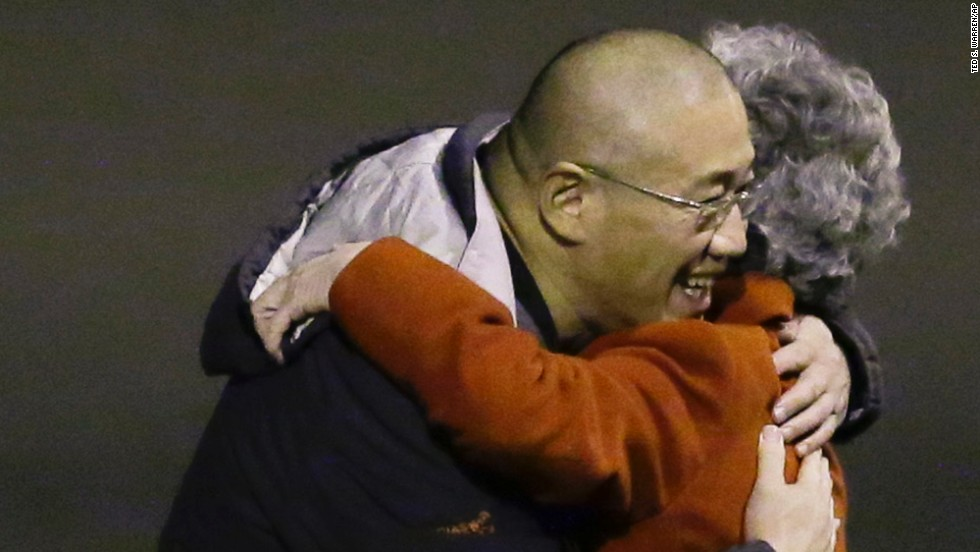 Kenneth Bae, who had been held in North Korea since 2012, greets his mother Myunghee Bae after arriving, Saturday, Nov. 8, 2014, at Joint Base Lewis-McChord, Washington, after Bae and Matthew Todd Miller, who was held in North Korea since April, 2014, were freed during a top-secret mission by James Clapper, U.S. director of national intelligence.