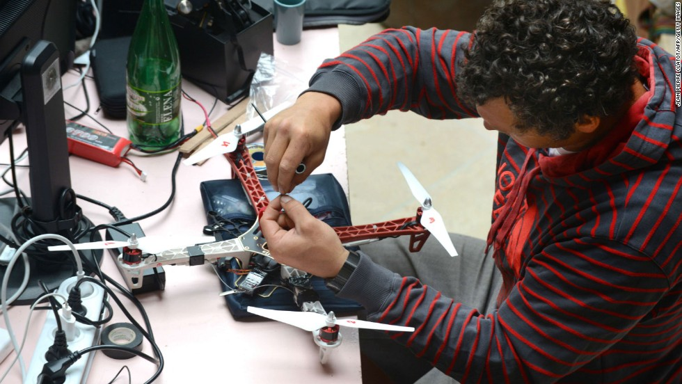 "Increasingly, pro athletes are using drones for their own benefit. <a href=""http://cnn.com/2014/01/29/sport/xavier-de-le-rue-snowboarding-sochi/"">French snowboarder Xavier de le Rue </a>is pictured working on a drone prototype in the summer of 2014."