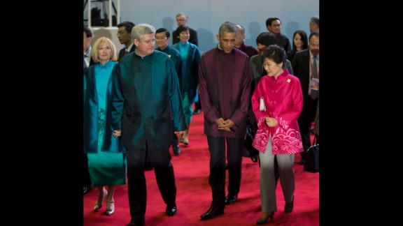 U.S. President Barack Obama, second right, walks with South Korean President Park Geun-hye, right, and Canadian Prime Minister Stephen Harper, second left, and his wife, Laureen, at the Asia-Pacific Economic Cooperation (APEC) Summit family photo, Monday, Nov. 10, 2014 in Beijing. (AP Photo/Pablo Martinez Monsivais)