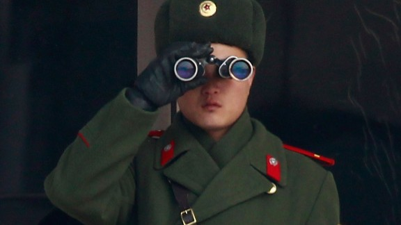 File photo: A N. Korean soldier looks at S. Korea across the Korean Military Demarcation Line (MDL) separating South and North Korea, on December 28, 2011 in Panmunjom, S. Korea.