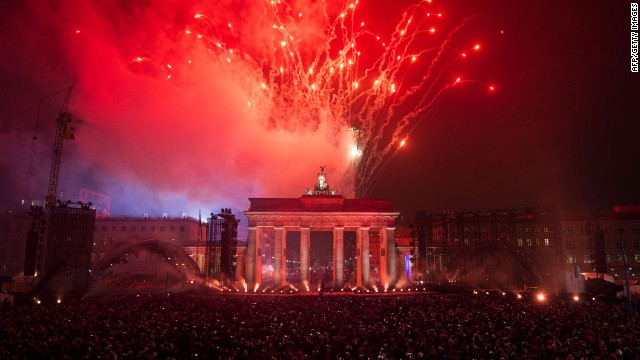 People watch fireworks after the release of balloons part of the light installation Lichtgrenze from the former route of the Berlin Wall during a Street Party organized by German governement to mark the 25th anniversary of the fall of the Berlin Wall, in front of the Brandenburg Gate on November 9, 2014 in Berlin. AFP PHOTO / ODD ANDERSENODD ANDERSEN/AFP/Getty Images