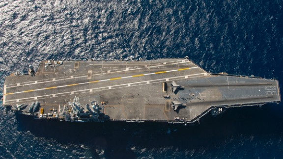 Two F-35C Lightning fighters are set for launch from the catapults of the aircraft carrier USS Nimitz in the Pacific Ocean. The F-35C, the Navy