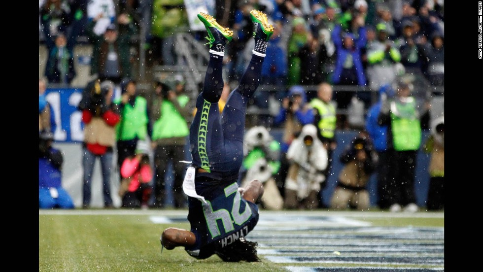 Running back Marshawn Lynch of the Seattle Seahawks dives into the end zone for a touchdown during the fourth quarter against the New York Giants at CenturyLink Field in Seattle on Sunday, November 9. Seattle won 38-17.