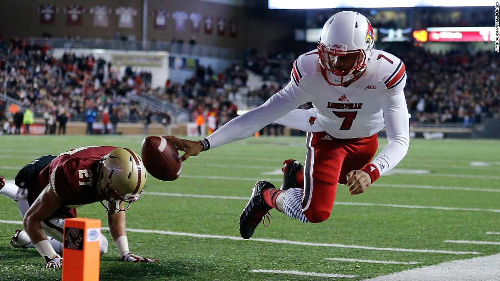 Reggie Bonnafon of the Louisville Cardinals comes up short of the end zone as Justin Simmons of the Boston College Eagles defends in the second quarter at Alumni Stadium in Chestnut Hill, Massachusetts, on Saturday, November 8. The Cardinals won 38-19.