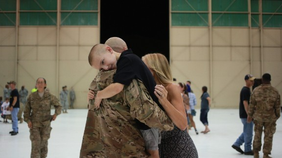 Bradyn Vest hugs his dad, Sgt. 1st Class Kevin Vest, after a homecoming ceremony September 1 in Fort Campbell, Kentucky.