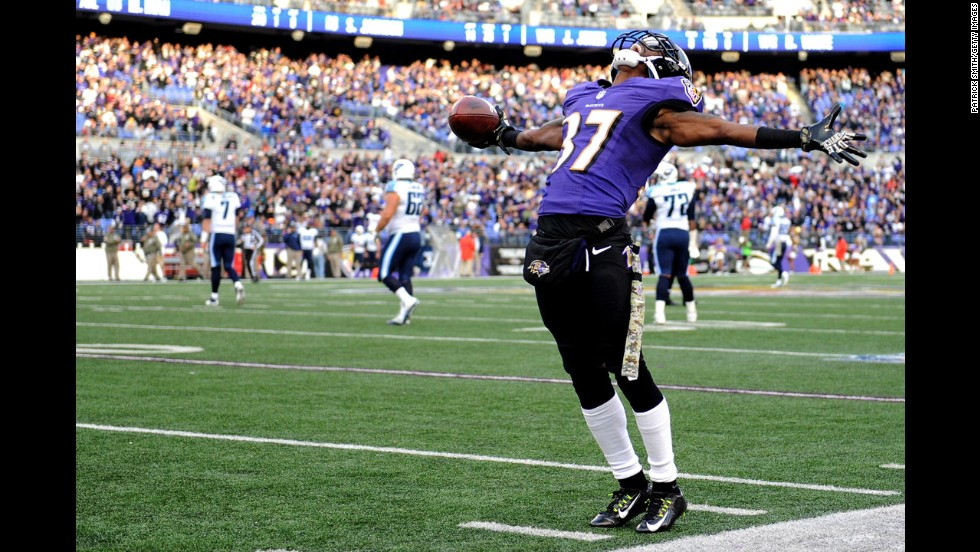 Cornerback Danny Gorrer of the Baltimore Ravens celebrates an interception in the fourth quarter against the Tennessee Titans at M&T Bank Stadium in Baltimore, Maryland, on Sunday, November 9.