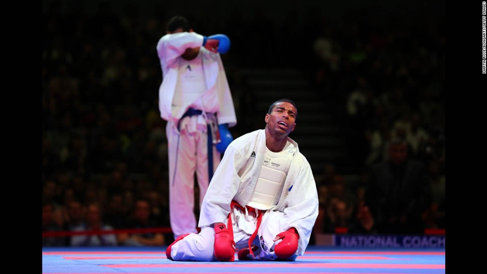 William Rolle of France celebrates on his knees after defeating Magdy Hanafy of Egypt during their men's gold medal bout in the Karate World Championships at OVB-Arena in Bremen, Germany, on Saturday, November 8.
