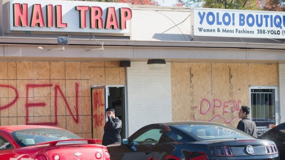 FERGUSON, MO - NOVEMBER 10:  Plywood covers the glass fronts of stores in a strip mall along West Florissant Street, on November 10, 2014 in Ferguson, Missouri.  Many businesses along West Florissant have recently been boarded-up as business owners wait for the grand jury decision in the shooting death of Michael Brown. Many of the stores along the street were looted and vandalized during rioting which broke out after Brown was killed by Darren Wilson, a Ferguson police officer. The city is hoping to avoid a repeat of those riots if the grand jury investigating the shooting does not find justification to prosecute Wilson.  The grand jurys decision is expected sometime in November.  (Photo by )