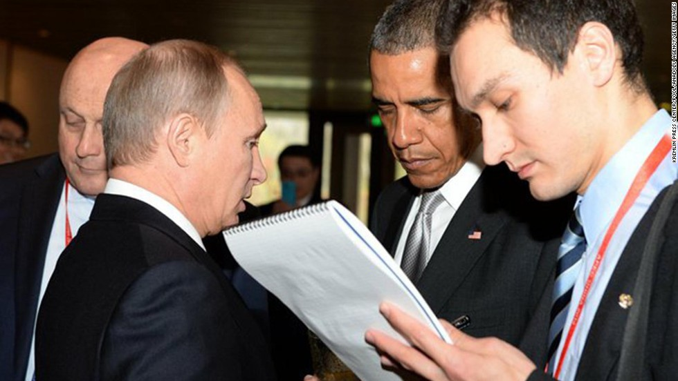 Putin, second left, speaks with Obama on Tuesday, November 11, during the APEC summit in Beijing.