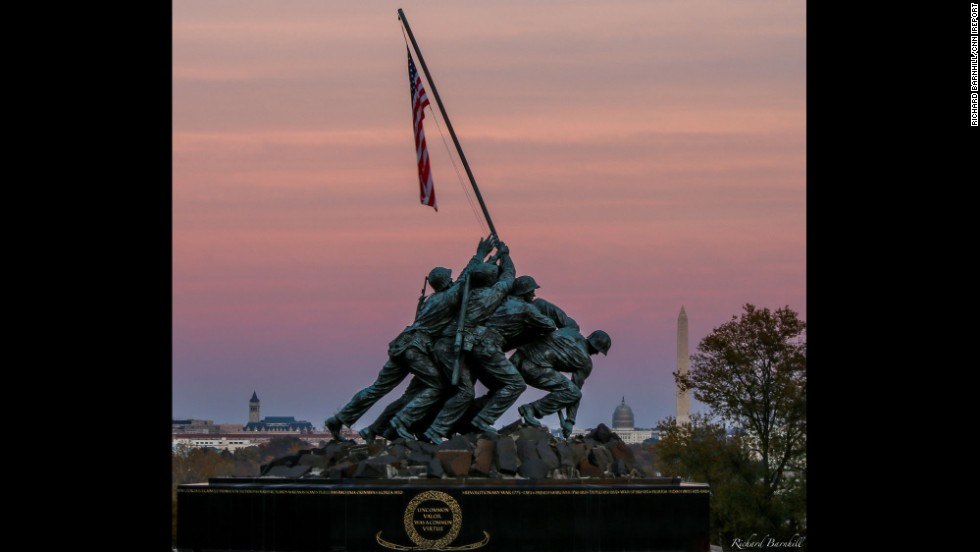 "As the sun set around Washington, D.C., <a href=""http://ireport.cnn.com/docs/DOC-1187523"">Richard Barnhill </a>caught this shot of the Marine Corps War Memorial against the pink fall sky. The<a href=""http://www.nps.gov/gwmp/historyculture/usmcwarmemorial.htm"" target=""_blank""> Marine Corps War Memorial</a> inscription reads: ""In honor and in memory of the men of the United States Marine Corps who have given their lives to their country since November 10, 1775."""