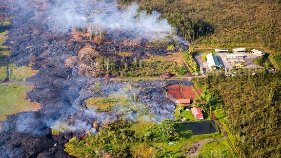 Lava flows near a residential structure in Pahoa, Hawaii, on Monday, November 10. The lava flow from the Kilauea Volcano is advancing on the community of about 950 people on Hawaii