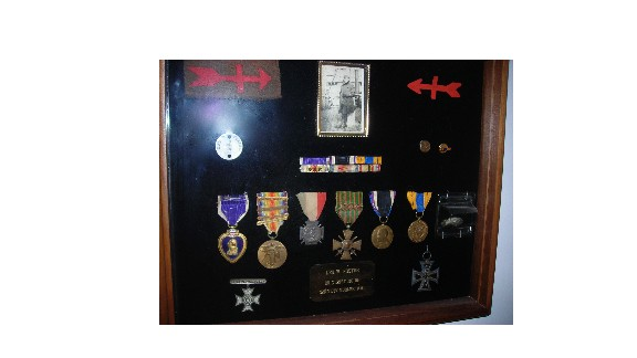 A shadowbox contains Leo Foster