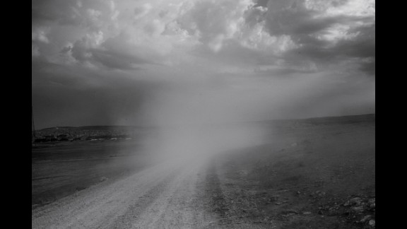 Dust rises from the road on the Syrian border.