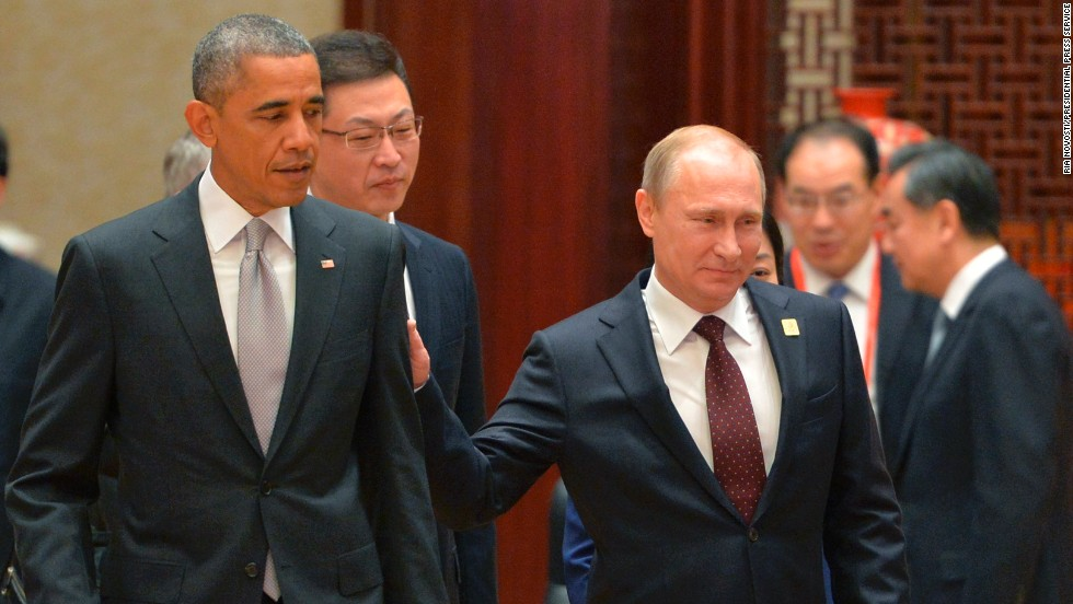 Russian President Vladimir Putin, right, passes U.S. President Barack Obama at the Asia-Pacific Economic Cooperation summit in Beijing on Tuesday, November 11. Putin had brief conversations with the leaders of Vietnam, Indonesia, Australia and the United States during breaks between official APEC summit events.