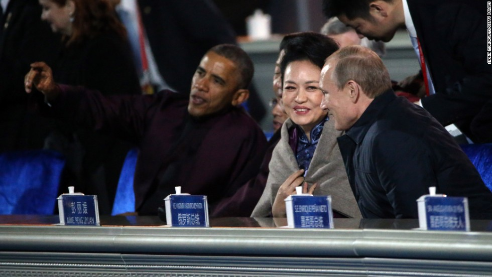 Obama; from left, Chinese President Xi Jinping; Xi's wife, Peng Liyuan; and Putin watch a fireworks display during the APEC meeting in Beijing on November 10.