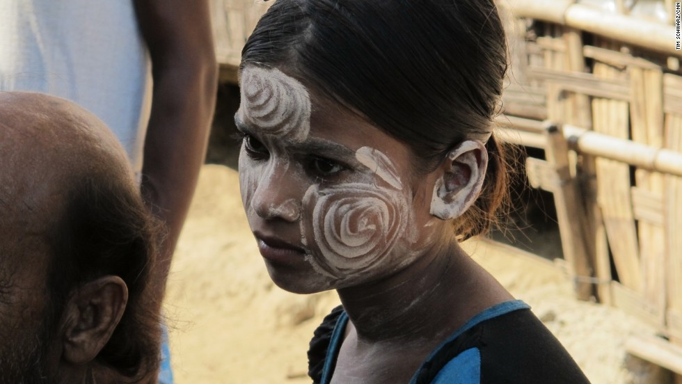 A young Muslim girl wears the traditional thanakha on her face. Thanakha is a paste made from ground bark that protects the skin from the sun and is appreciated for its aesthetic appeal.