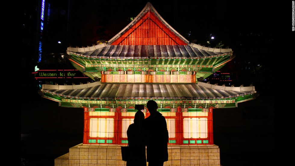 A couple takes a selfie in front of lanterns in downtown Seoul, South Korea, on Thursday, November 6. An annual lantern festival takes place along the city's Cheonggyecheon Stream from November 7 to November 23.