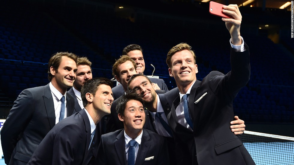 Tomas Berdych takes a selfie with fellow tennis players, from left, Roger Federer, Stan Wawrinka, Novak Djokovic, Kei Nishikori, Andy Murray, Milos Raonic and Marin Cilic ahead of the ATP World Tour tennis finals in London on Friday, November 7.