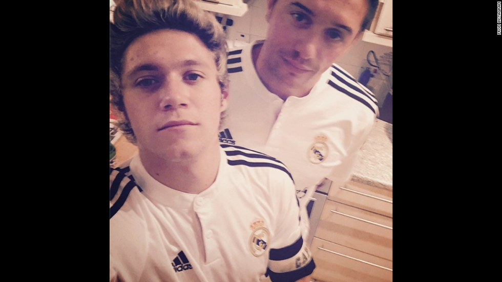"Niall Horan of One Direction <a href=""http://instagram.com/p/vGXMOAMyNd/"" target=""_blank"">shared this selfie</a> he took with his friend David Soutar on Friday, November 7. ""Throwback to our Real Madrid days."" he said."
