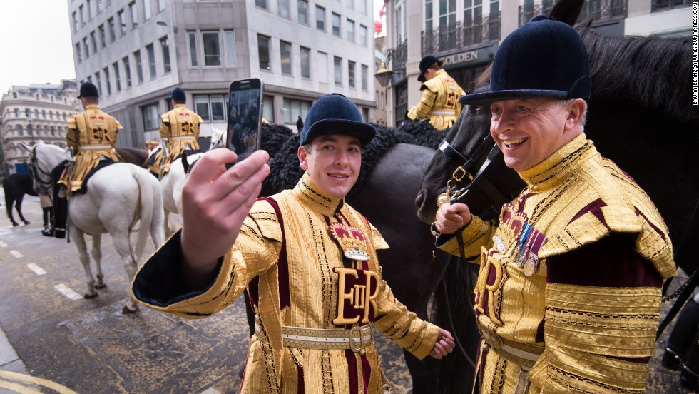 Riders take a selfie while waiting to escort the newly appointed Lord Mayor of London's State Coach as part of the Lord Mayor's Show in London on Saturday, November 8.