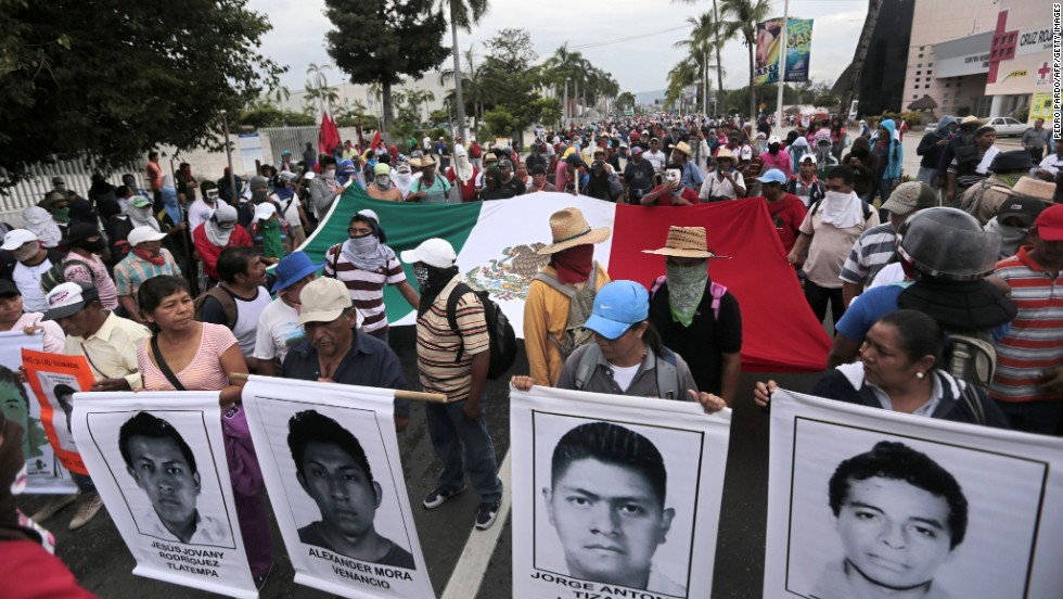 Protesters march in Acapulco on November 10.