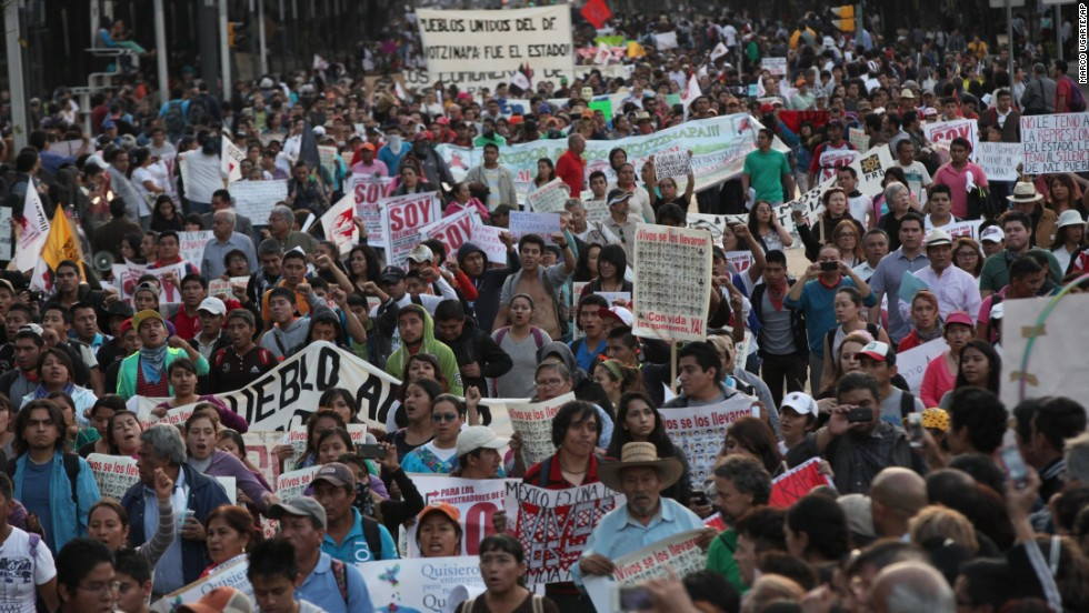 Tens of thousands of demonstrators march in Mexico City on Wednesday, November 5, demanding that the missing students be found alive.