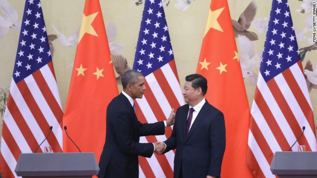 President Barack Obama (L) shakes hands with President Xi Jinping (R) in Beijing last year.