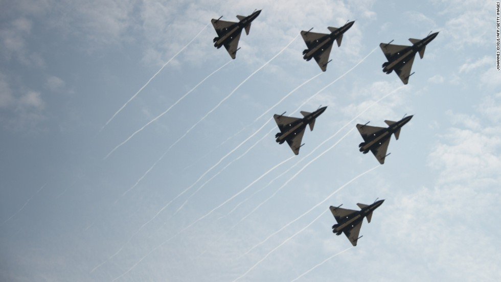 J-10 fighter jets of the Bayi Aerobatic Team of the Peoples Liberation Army Air Force perform during the air show on Tuesday, November 11, 2014.