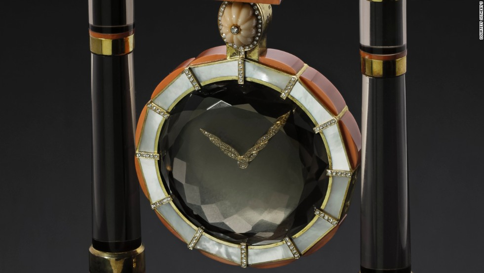A Cartier Mystery Clock made of silver gilt, diamond, mother-of-pearl, smoky quartz and coral sold for $215,711.