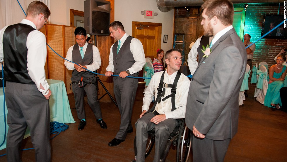 Joey Johnson uses a wheelchair but wanted to surprise his bride by standing for their first dance, so he asked his groomsmen to help rig up a contraption that would let him stand during the song.