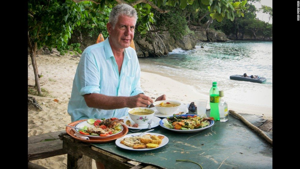 Anthony Bourdain enjoys a sampling from different food vendors at Winnifred Beach.