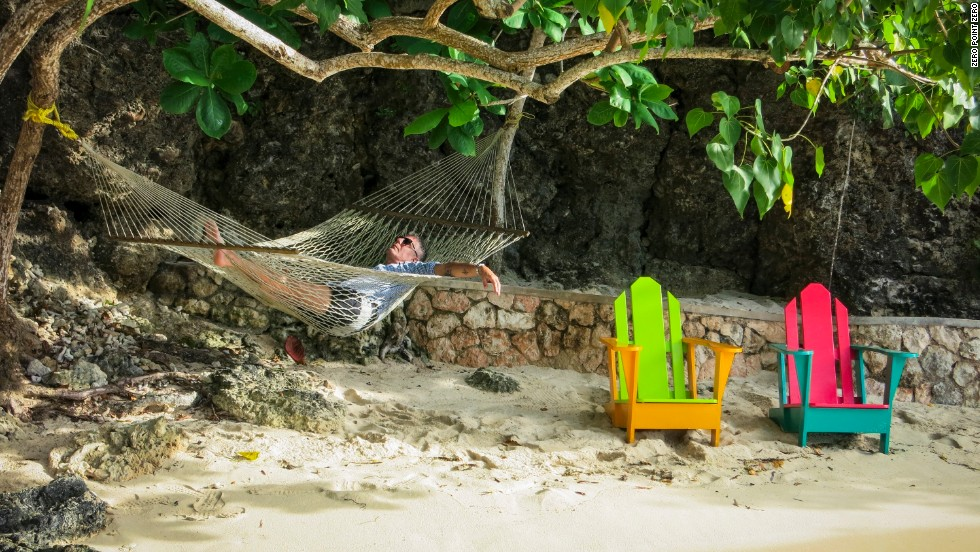 Bourdain relaxes on the private beach at the Ian Fleming Villa at Goldeneye in Oracabessa.