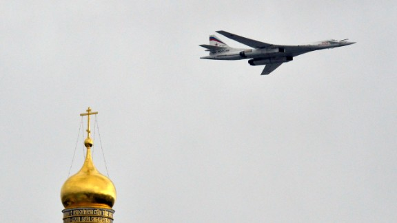 Caption:A Russian Tupolev Tu-160 supersonic strategic bomber flies above the Kremlin's cathedrals in Moscow, on May 7, 2014, during a rehearsal of the Victory Day parade. Russia celebrates the1945 victory over Nazi Germany on May 9. AFP PHOTO / YURI KADOBNOV (Photo credit should read YURI KADOBNOV/AFP/Getty Images)