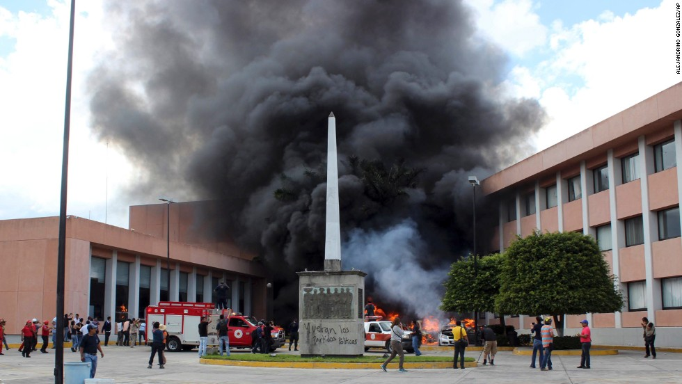 "Protesters angry at the apparent <a href=""http://www.cnn.com/2014/10/05/americas/gallery/mexico-missing-students/index.html"" target=""_blank"">death of 43 students</a> torched vehicles in front of the state Congress building in Chilpancingo, Mexico, on Wednesday, November 12. The students disappeared in southern Mexico in September. <a href=""http://www.cnn.com/2014/11/10/world/americas/mexico-missing-students-impact/index.html"">Authorities say they were abducted</a> by police on order of a local mayor, then turned over to a gang that's believed to have killed them and burned their bodies before throwing some remains in a river.<br />"