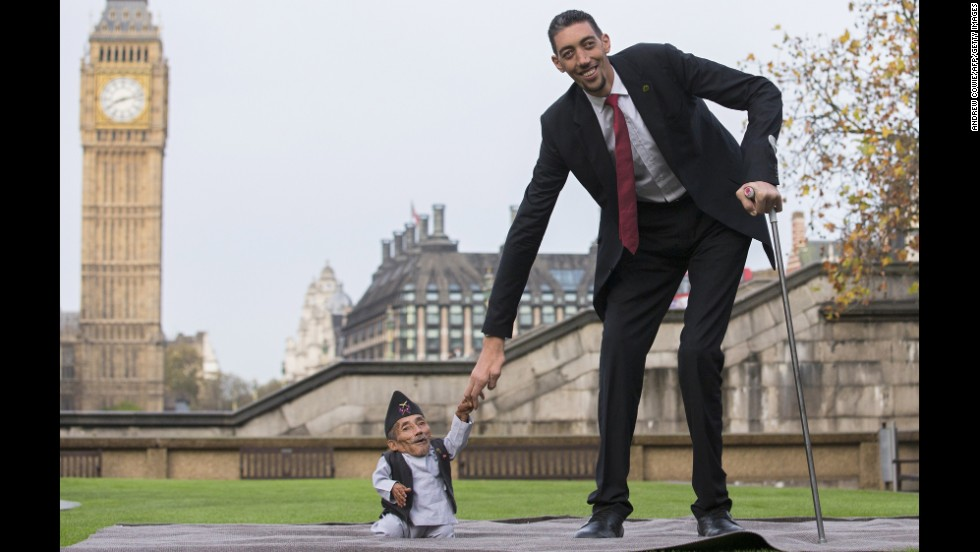 Chandra Bahadur Dangi, at 21½ inches the shortest adult ever verified by Guinness World Records, poses Thursday in London with the world's tallest man, Sultan Kosen, who stands 8 feet 3 inches tall.