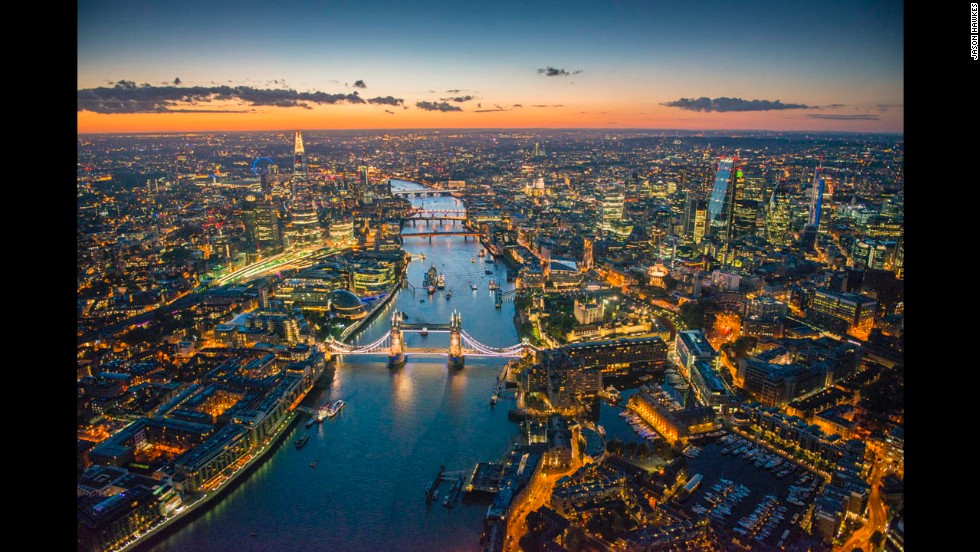 "<a href=""http://www.jasonhawkes.com/"" target=""_blank"">Aerial photographer Jason Hawkes</a> has been cruising the skies for bird's-eye views of cities since 1991. He set out to capture London, where he's based, this summer and fall. Here, the Tower Bridge and River Thames are seen at dusk. See more of his photos:"