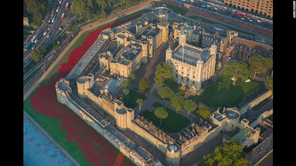 "The Tower of London and the <a href=""http://www.cnn.com/2014/11/07/world/europe/tower-of-london-poppies/"">poppies installation</a> ""Blood Swept Lands and Seas of Red,"" which represents a bloom for each life lost in World War I 100 years ago."