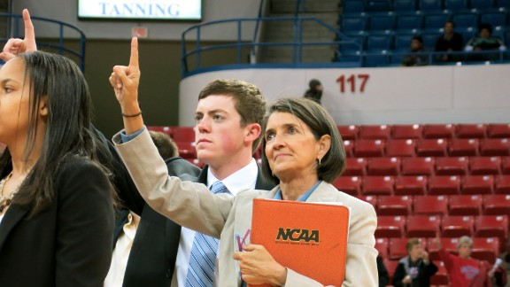 "Tyler Summitt stands with his assistant Mickie DeMoss, who also served as his mother's assistant coach for 18 seasons. ""I've been around a lot of coaches, and he ranks right up there in my book,"" she says."
