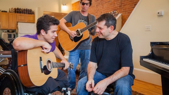 Arthur Bloom, right, rehearses with members of the MusiCorps Wounded Warrior Band at Bloom