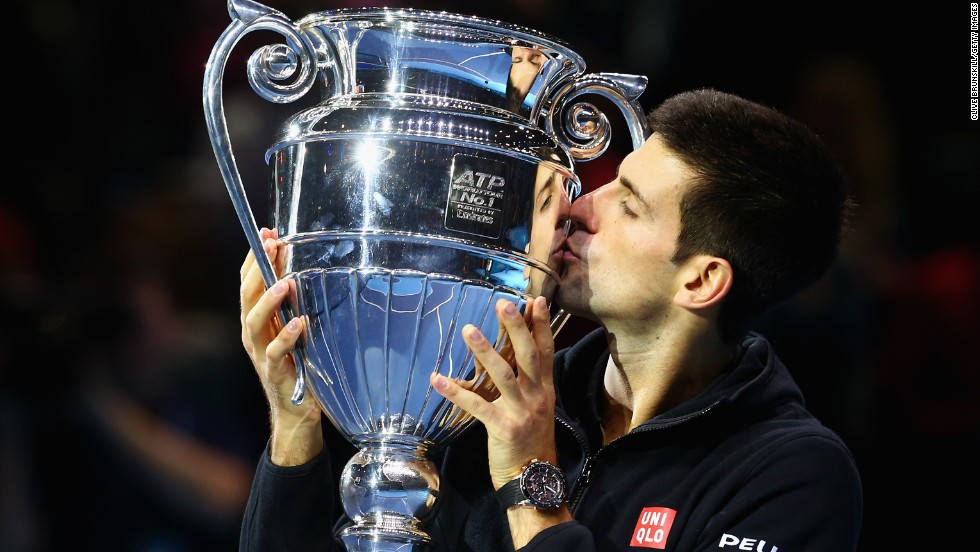 Novak Djokovic lifts the trophy awarded for year-end No.1 after his straight sets win over Tomas Berdych at the ATP World Tour Finals which sealed the ranking.