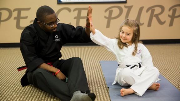 A student high-fives a teacher in Detroit.