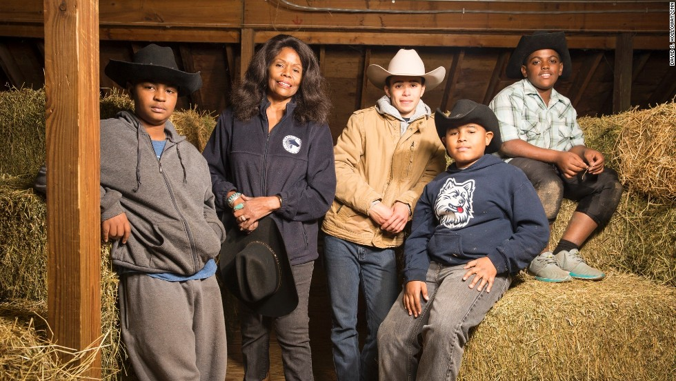 Kelly poses with members of the Junior Mounted Patrol, a program designed especially for young men.