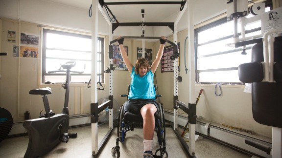 Norton's strength-training equipment is specially adapted to fit his clients' needs. Most of the people he trains are in wheelchairs and rely on their upper body strength to get around.