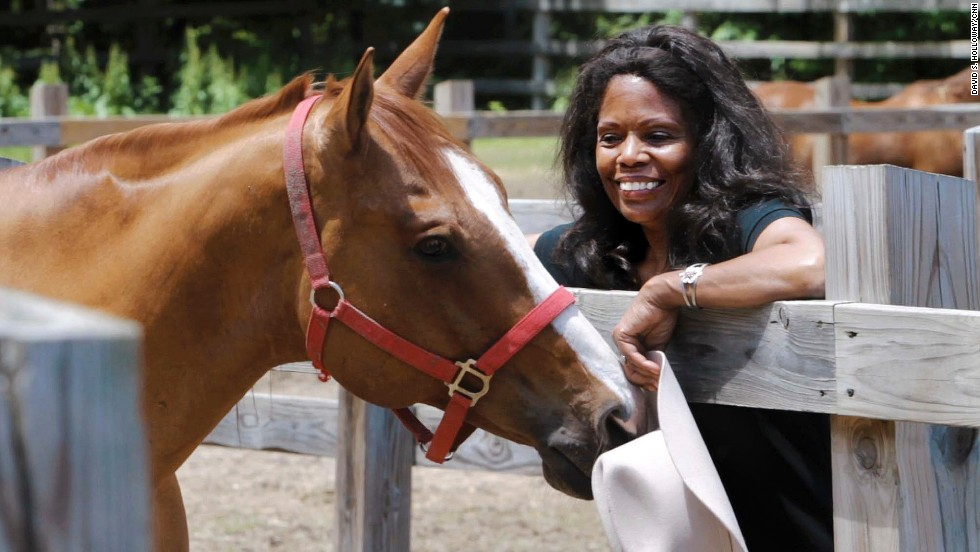 Kelly spends time with Chance, one of the horses at her farm.