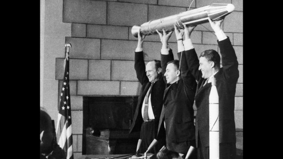 A model of Explorer 1, America's first satellite, is held by, from left, NASA official William Pickering, scientist James Van Allen and rocket pioneer Wernher von Braun. The team was gathered at a news conference at the National Academy of Sciences in Washington to announce the satellite's successful launch. It had been launched a few hours before, on January 31, 1958.