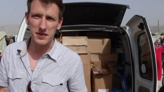 This Kassig Family released handout photo on October 4, 2014 shows Peter Kassig in front of a truck somewhere along the Syrian border between late 2012 and autumn 2013 as Special Emergency Response and Assistance (SERA) was delivering supplies to refugees before the American aid worker was held captive by Islamic State jihadists. The Islamic State jihadist group on November 16, 2014 claimed to have executed Peter Kassigas a warning to the United States, in video.