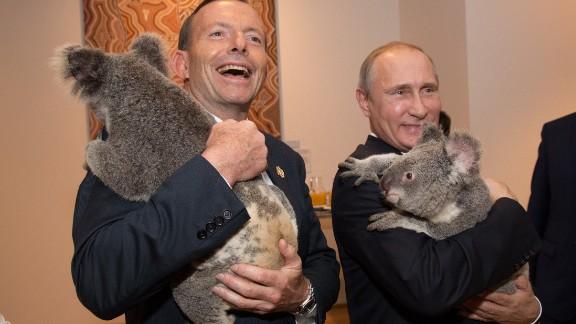 Australian Prime Minister Tony Abbott, left, and Russian President Vladimir Putin hold koalas on the sidelines of the G-20 summit on Saturday, November 15, in Brisbane, Australia.