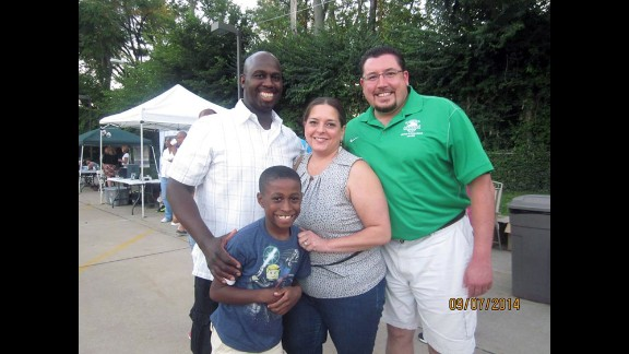 Stefannie Wheat with her husband, Ken, son Christopher and Ferguson Mayor James Knowles.