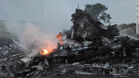 A picture taken on July 17, 2014, shows flames amid the wreckage of Malaysia Airlines Flight 17 in rebel-held eastern Ukraine.