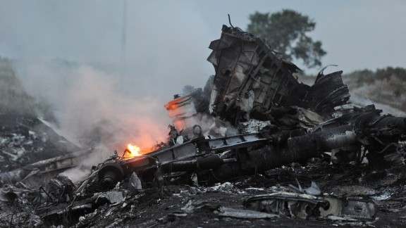 A picture taken on July 17, 2014 shows flames amongst the wreckages of Malaysia Airlines Flight 17 in rebel-held eastern Ukraine.